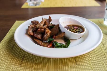 thai style: thai style grilled pork served in restaurant