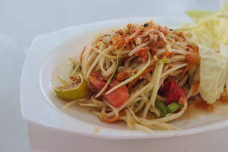 thai style spicy papaya salad closeup photo