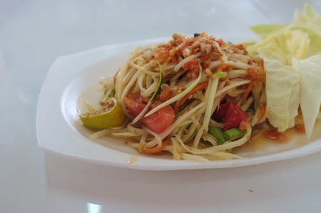 somtam is papaya salad of thailand, mixed with vegetable photo
