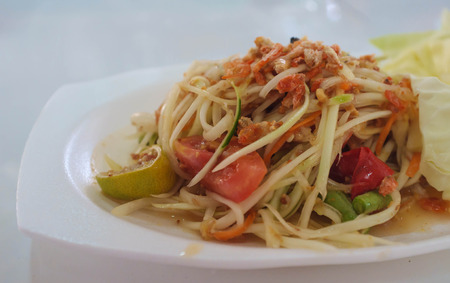 thai style spicy papaya salad photo