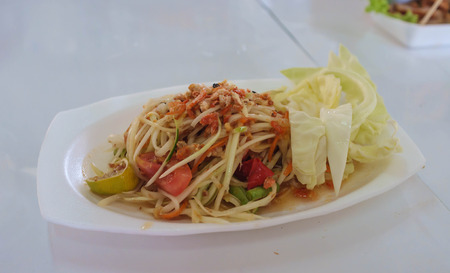 thai style spicy papaya salad mixed with vegetable photo