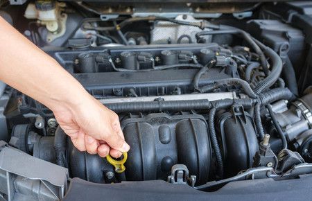 car protection: modern car need maintainance with engine oil Stock Photo