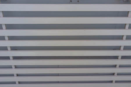 car park interior: white wooden ceiling inside building Stock Photo
