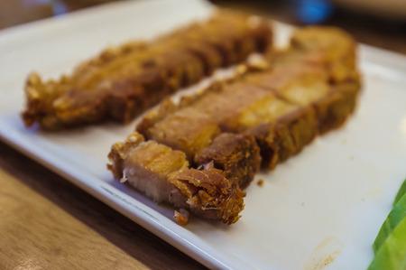 thai style: thai style crispy pork served in restaurant