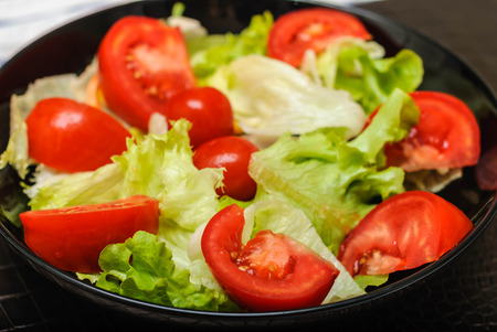 organic fresh salad with red tomato photo