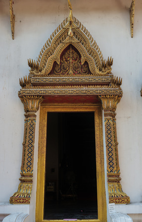 thai craft: grand entrance of traditional Thai temple with craft decoration
