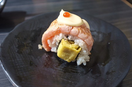 egg roll: salmon and egg roll served in traditional Japanese restaurant Stock Photo