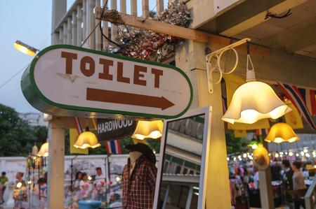 public market sign: toilet sign guidance in public building