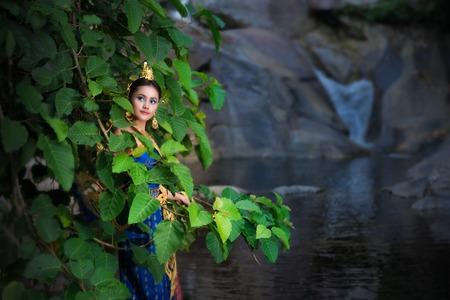 The Angel Fashion at Wang Mai Pag Waterfall in Thailand. Stock Photo