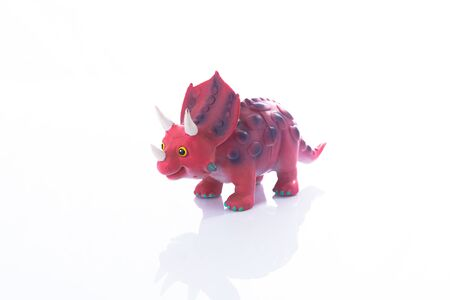Dinosaur Toy Isolated On White acrylic.This is high-key photo