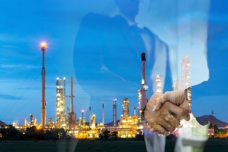 oil and gas industry: Double exposure man survey oil refiery plant, and chemical plant in Thailand, oil tank, oil storage, and pipeline Stock Photo