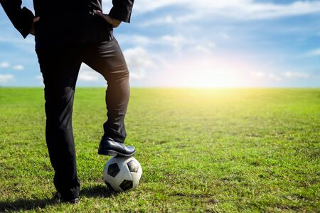 businessman with a soccer ball on a pitch.Business sport concept 스톡 콘텐츠