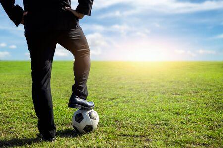 businessman with a soccer ball on a pitch.Business sport concept Standard-Bild