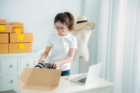 Fashion designer stylish showroom concept, Young asian girl is freelancer with her private business at home office