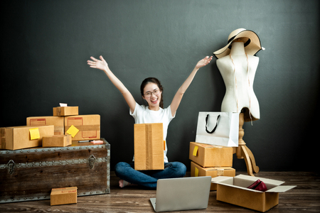 Young asian girl is freelancer with her business at home office, Online marketing, Customer order and packaging or packing 版權商用圖片