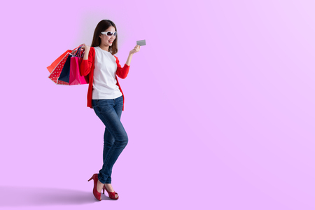 Young happy summer shopping woman with shopping bags isolated , Portrait of young happy smiling woman with shopping bags , advertising 版權商用圖片