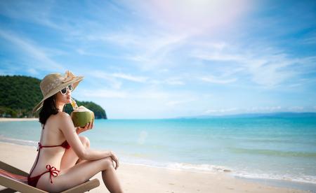 Sexy woman in the red bikini and sunhat on sea beach.travel summer beach 版權商用圖片