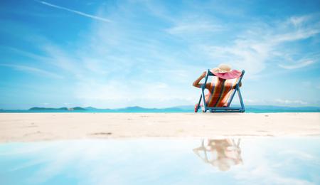 Sexy woman in the bikini and sunhat on sea beach.travel summer beach