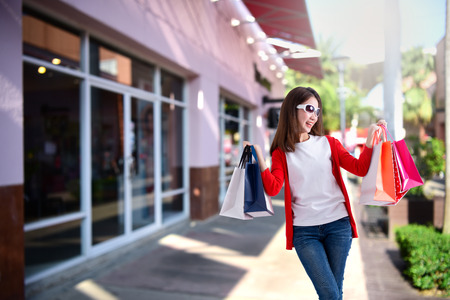 Young happy woman with shopping bags , Portrait of young happy smiling woman with shopping bags , advertising 스톡 콘텐츠