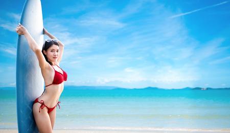 Sexy woman in the red bikini on sea beach.travel summer beach