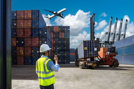 Foreman control loading Containers box to truck for Logistic Import Export Background, Business logistic concept, import and export concept 스톡 콘텐츠