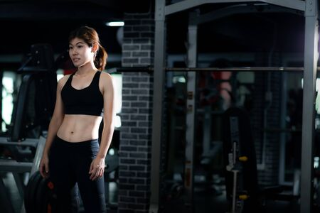 Asian fitness woman in Gym. lifestyle portrait 스톡 콘텐츠