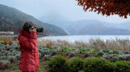 Professional Nature Photographer taking photo on morning lake.travel concept