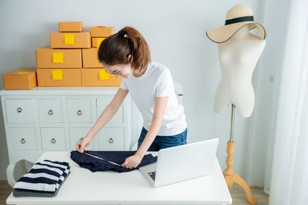 Young asian girl is freelancer with her private business at home office. Fashion designer stylish showroom concept