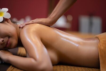 Young Beautiful Asian Woman relax massage in spa salon