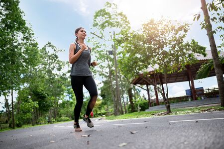 young asian woman runner athlete running at garden . sport , healthy