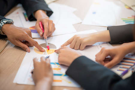 Consultation of Business man and business woman consider business plan in office workers