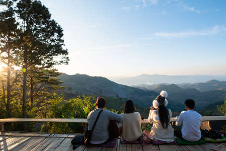 Group of tourists drink coffee on mountain view.Doi AngKang Thailand