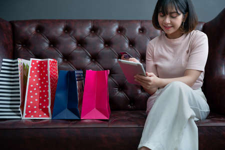 Portrait of young happy smiling woman with shopping bags ,Young happy summer shopping woman