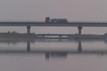 truck went over the bridge foggy morning Reklamní fotografie