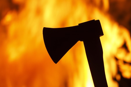 raged: ax against a background of fire, knives, fires raged Stock Photo