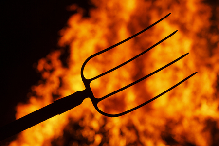 hell fork on the background of fire,Halloween. symbol hell, mysticism Stock Photo