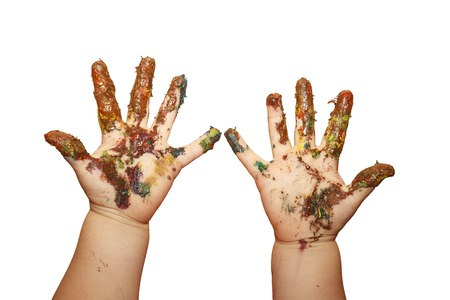 Childrens hands smeared in gouache paints isolated on white