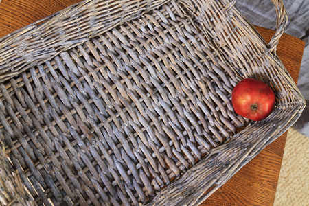 red apple lying on the bottom of wooden box,last residue fruit basket, vintage Stock Photo