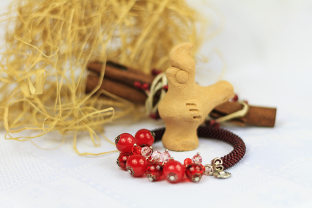 handmade jewelery instructions clay rooster and bracelet,China, India, decorations, handmade, beads jewelry Stock Photo