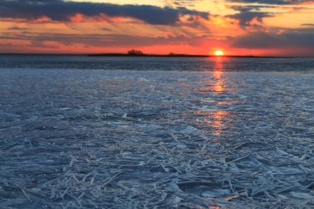 funny ice crystals at sunset,spring, end of winter, texture, silhouettes, golden hour, blue hour