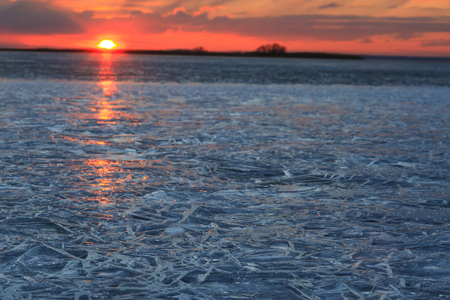 last ice in late winter,spring, end of winter, texture, silhouettes, golden hour, blue hour