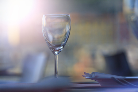 one glass of wine is on the table with sunny hotspot,restaurant wine list, a table with a glass, interior cafes, themed restaurant