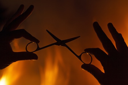 hands of hairdressing scissors against a background of fire,Master class haircuts, hair salon, stylish beauty salon, barbershop