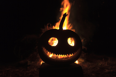 flame that burns behind the pumpkins head