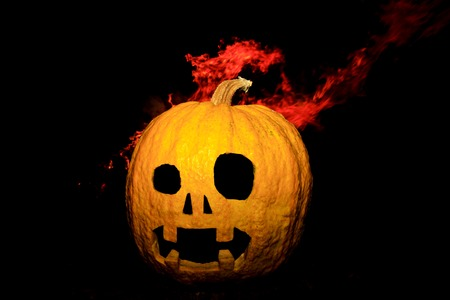 pumpkin head made with hands and flame Stock Photo