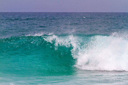 turquoise wave breaks up to the shore