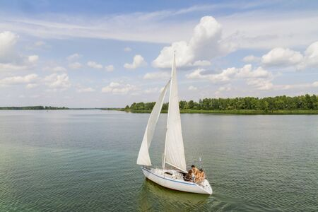 sailboat sail along the scenic river Imagens - 128754723