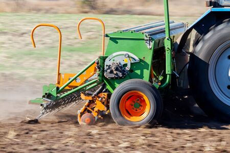 seeder sows wheat in black soil, exclusive