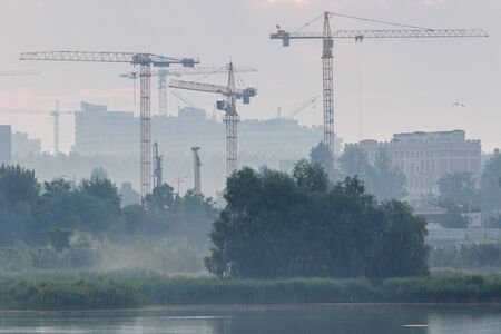 operating cranes restore the city after the disaster