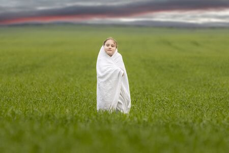 girl in white among the green field